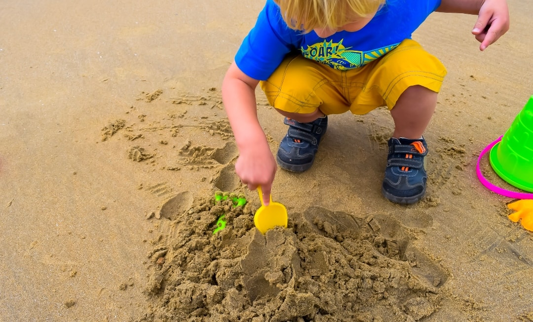 A photograph of a blonde haired little boy building a sand castle on a beach - Konfidence Sand Art Competition 2019 - Mrs H's favourite thingsA photograph of a blonde haired little boy building a sand castle on a beach - Konfidence Sand Art Competition 2019 - Mrs H's favourite things