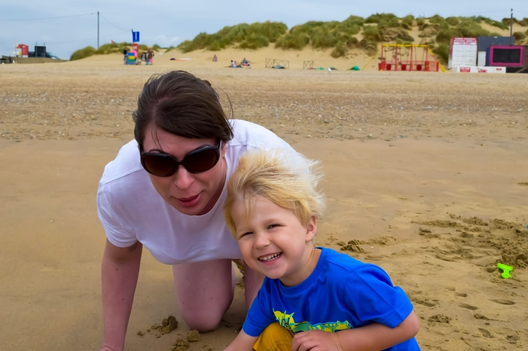 A photograph of a mother and her young son on a beach at Camber Sands - Konfidence Golden Bucket Sand Art Competition 2019 - Mrs H's favourite things