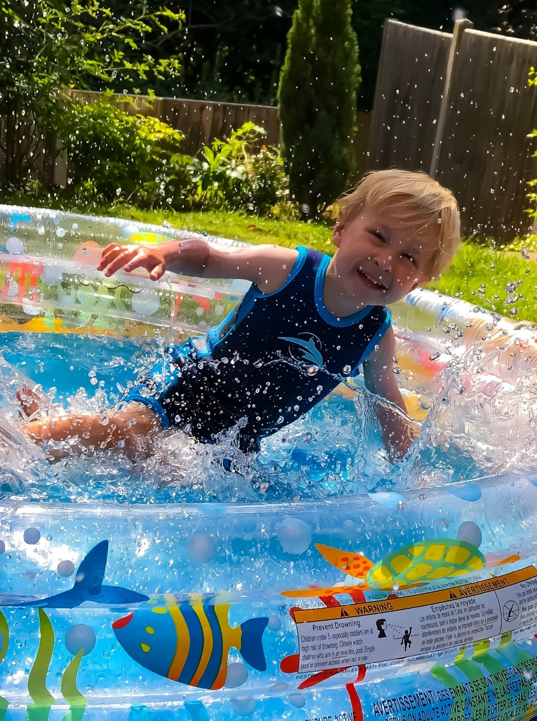 A photograph of a little boy playing in a paddling pool - Snapshots Of Our Summer - Mrs H's favourite things