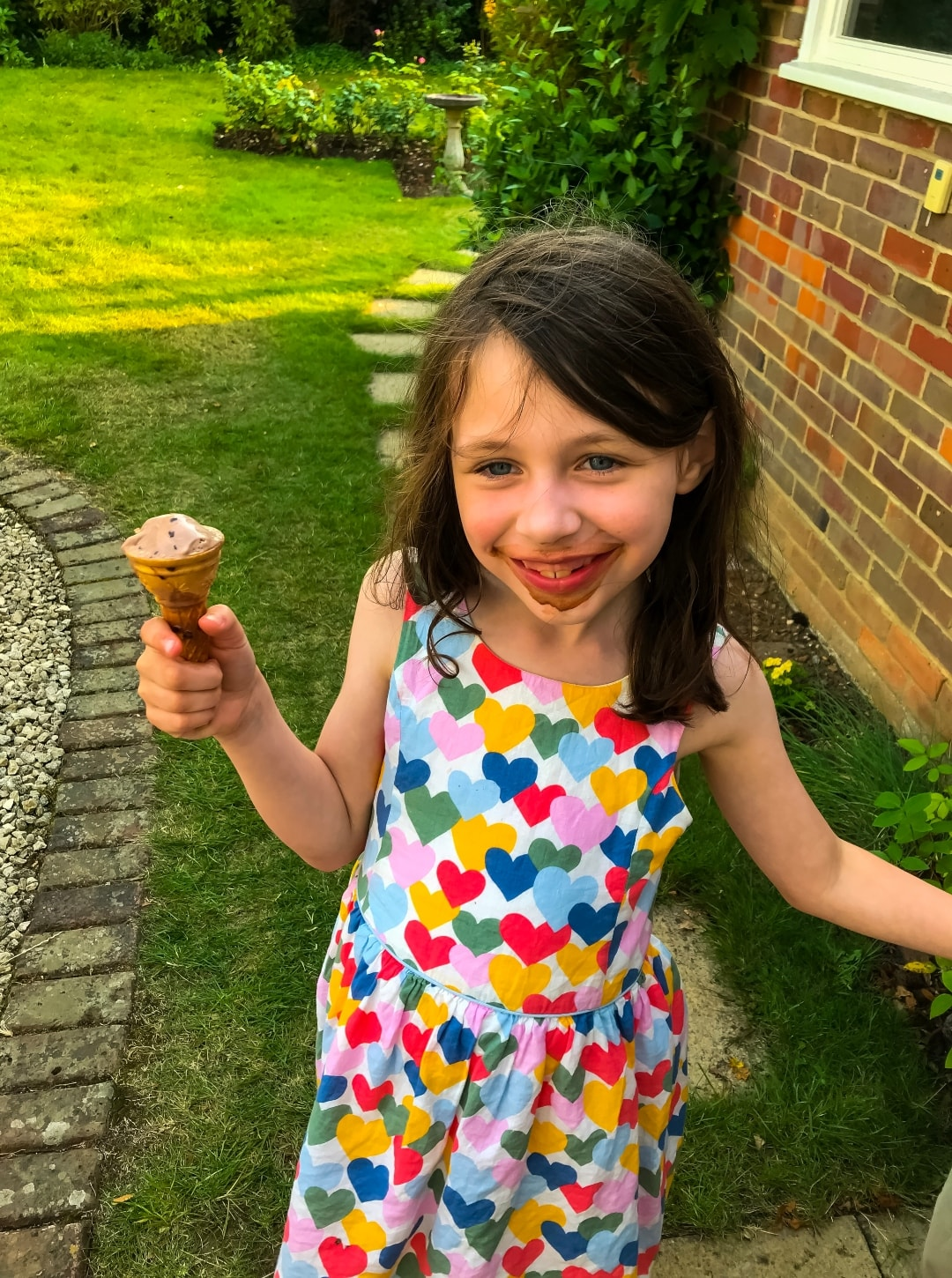 A photograph of a little girl eating a chocolate ice cream - Snapshots Of Our Summer - Mrs H's favourite things