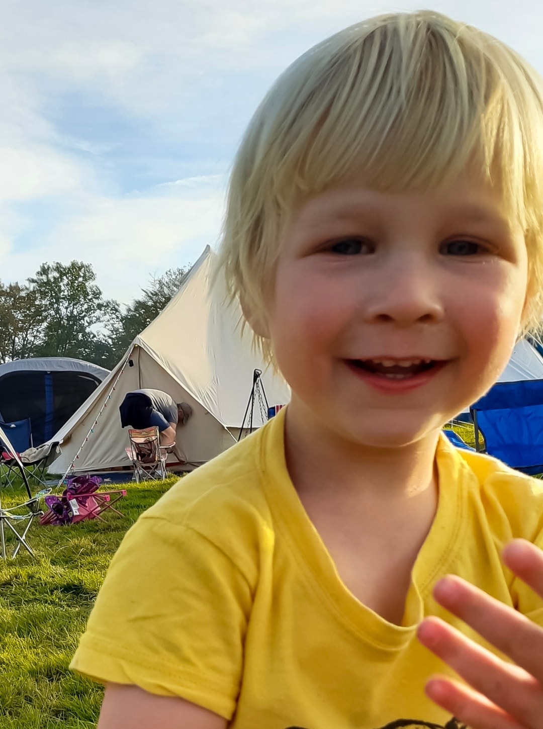 A photograph of a little boy smiling at Into The Trees festival - Into The Trees 2019 - An Idyllic Family Festival - Mrs H's favourite things