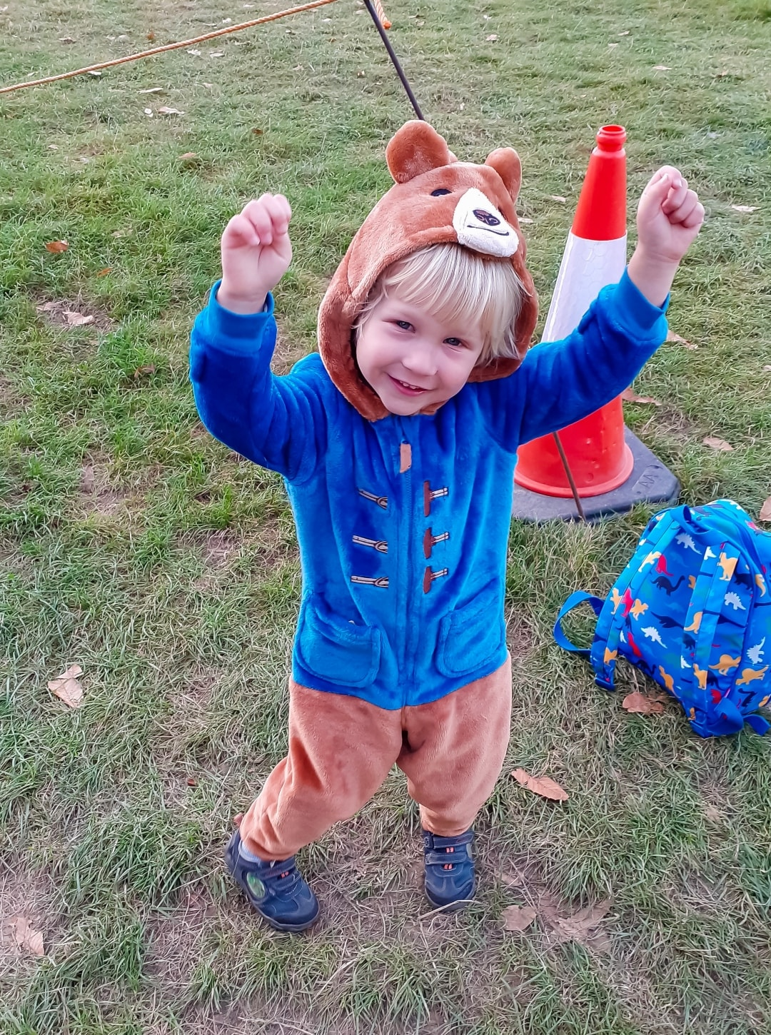 A photograph of a little boy dressed in a onesie at Into The Trees festival 2019 - Into The Trees 2019 - An Idyllic Family Festival - Mrs H's favourite things