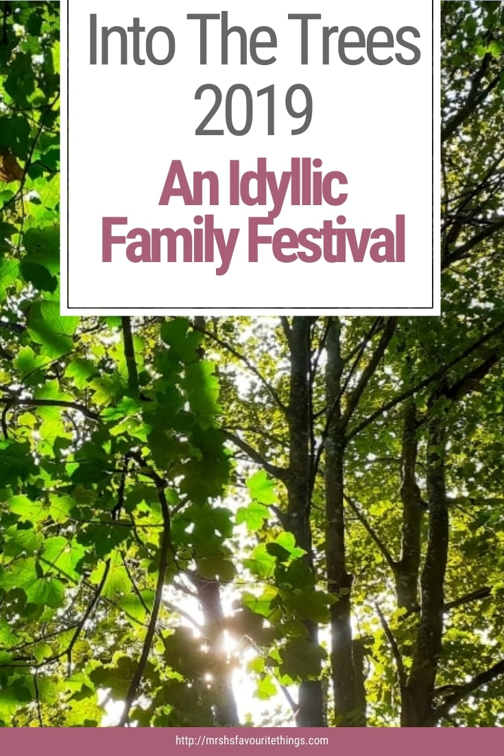 """A Pinterest friendly image of some trees with the text """"Into The Trees 2019 - An Idyllic Family Festival"""" - Into The Trees 2019 - An Idyllic Family Festival - Mrs H's favourite things"""