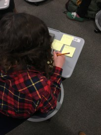 Students plan their narrative structure, modeled after mentor text