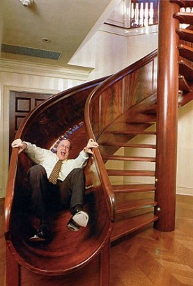 A slide right next to the staircase!