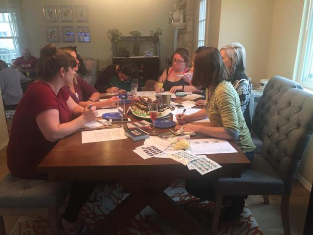 Friends write postcards to their elected officials at a postcard party