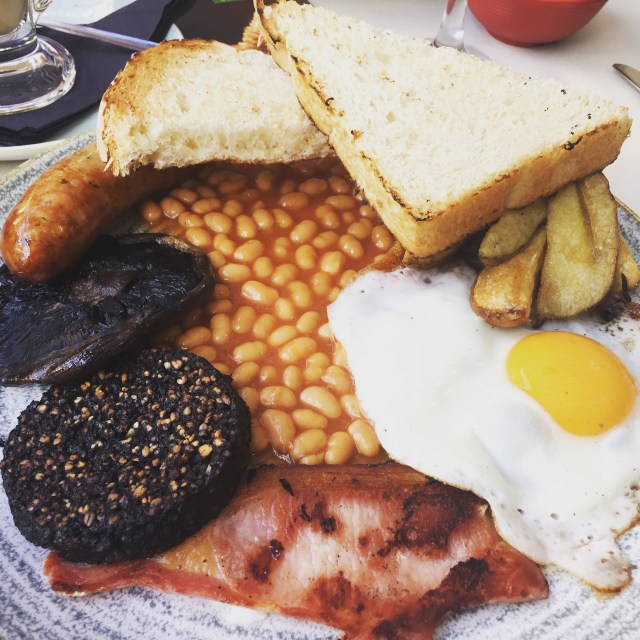 "Sausage, mushroom, black pudding, bacon, egg, beans, chips, and toast: a ""proper"" Irish breakfast."