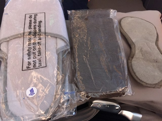 As Singapore doesn't provide amenity kits, the stewardesses passed out slippers, socks, and eye masks just after the first meal service.
