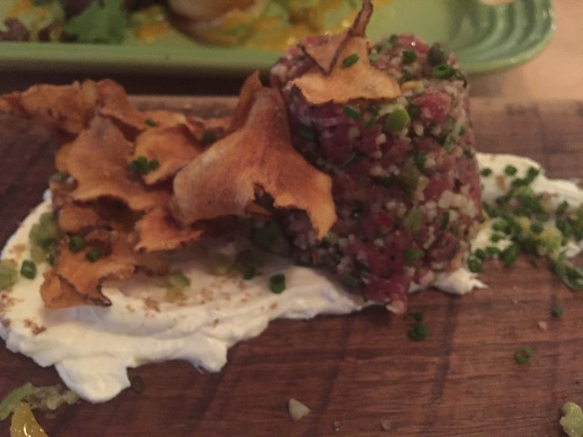 The lamb tartare appetizer at Butcher and Bee in Charleston, South Carolina, served with toasted chips and labneh cheese.