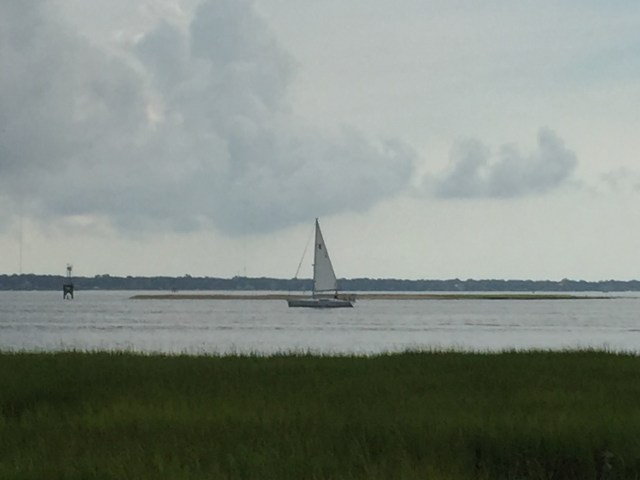 A sailboat crosses the harbor near the Battery at White Point Gardens in Charleston, South Carolina.