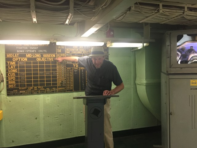 The hubby re-enacting a pre-mission pilot's briefing aboard the USS Yorktown at Patriot's Point in Charleston.