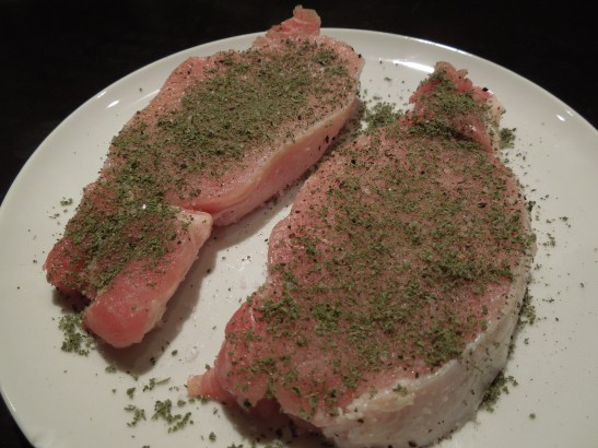 Image of pork steaks rubbed with sage