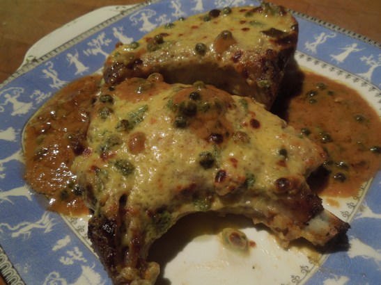 Image of chops cooked and served with sauce