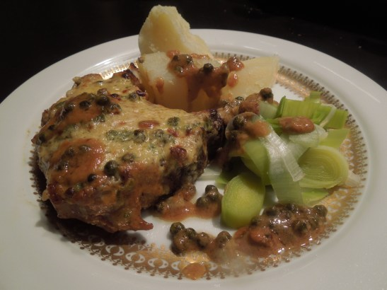 Image of chops served with boiled potatoes and leeks