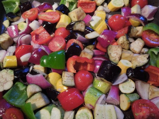Image of chunked vegetables tossed in oil