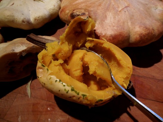 Image of flesh being scooped out of baked pumpkin