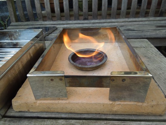 Image of burner lit for hot smoker