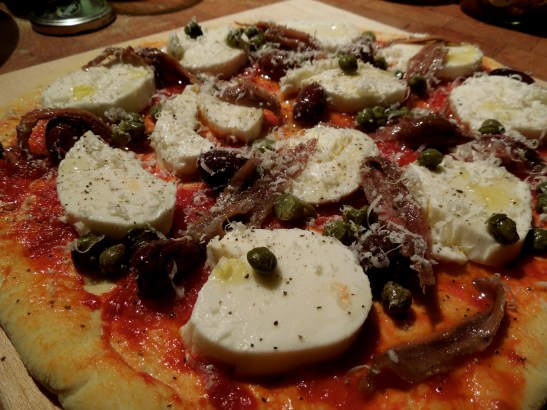 Image of pizza with toppings ready for oven