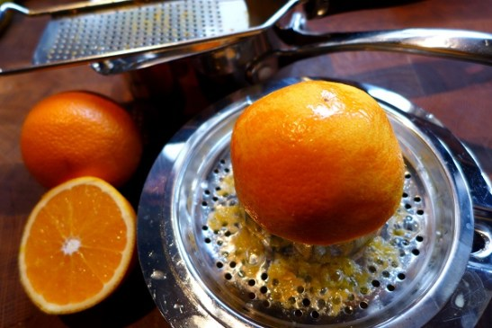 Image of orange being juiced