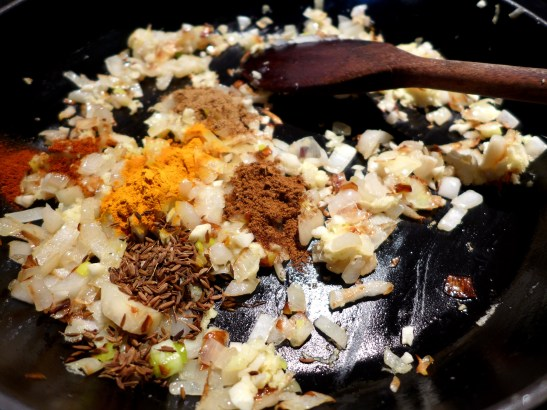 Image of spices added to pan