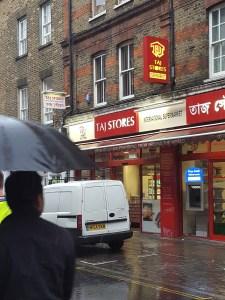Image of Taj Stores exterior in the rain