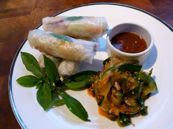 Image of crab and avocado summer rolls with dipping sauce and cucumber sangchae