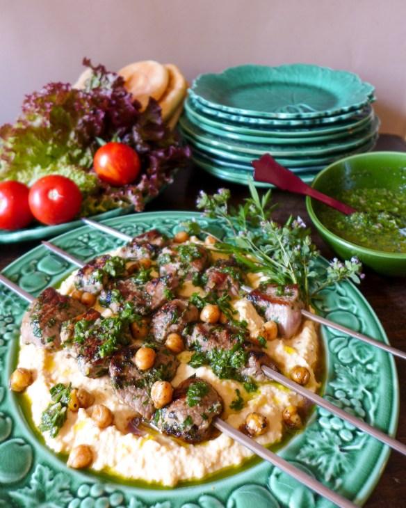 Image of Lamb kebabs with chimichurru andLamb Kebabs with Chimichurri and Smoky Hummus