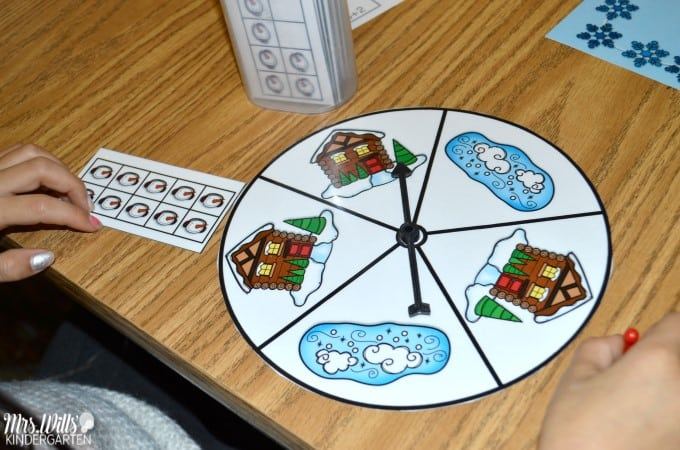 Kindergarten Math Center Activities and freebie files. These ideas will engage your class all year long. See how we practice counting, addition, shapes, and more while meeting the common core standards. These math worksheets and printables are a hit in my classroom! Free game included.