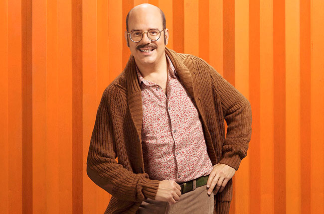 Tobias from Arrested Development posing in a brown sweater