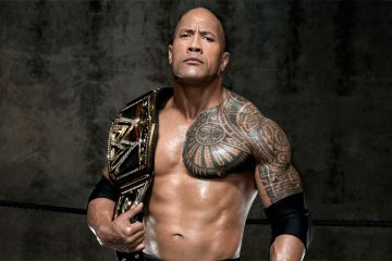 The Rock with WWE championship belt