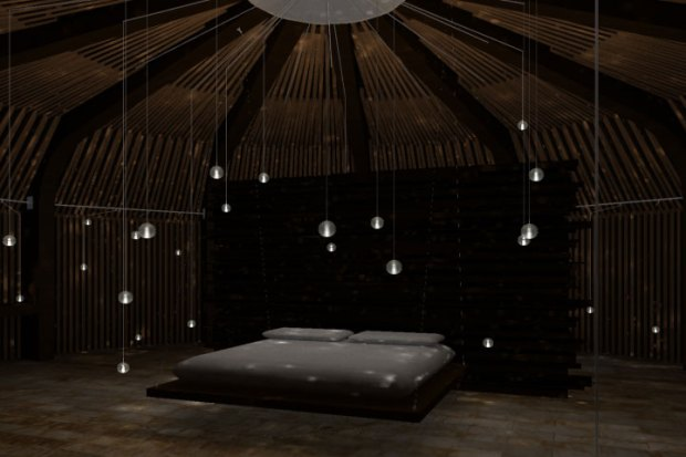 Dark peaceful room with lights hanging from the ceiling like stars.