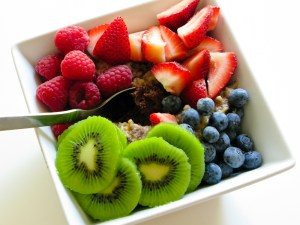 Square bowl of kiwi, strawberries, raspberries, and blueberries