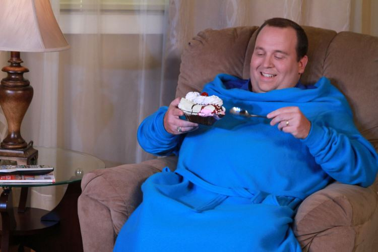 Guy eating ice cream in a blue snuggie