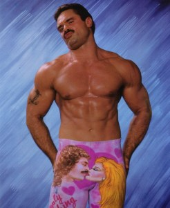 Ravishing Rick Rude wrestling pic posing in pink kissing spandex