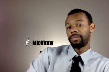 MicVinny in a shirt and tie talking about what you should do when the clock's go forward for daylight savings time.