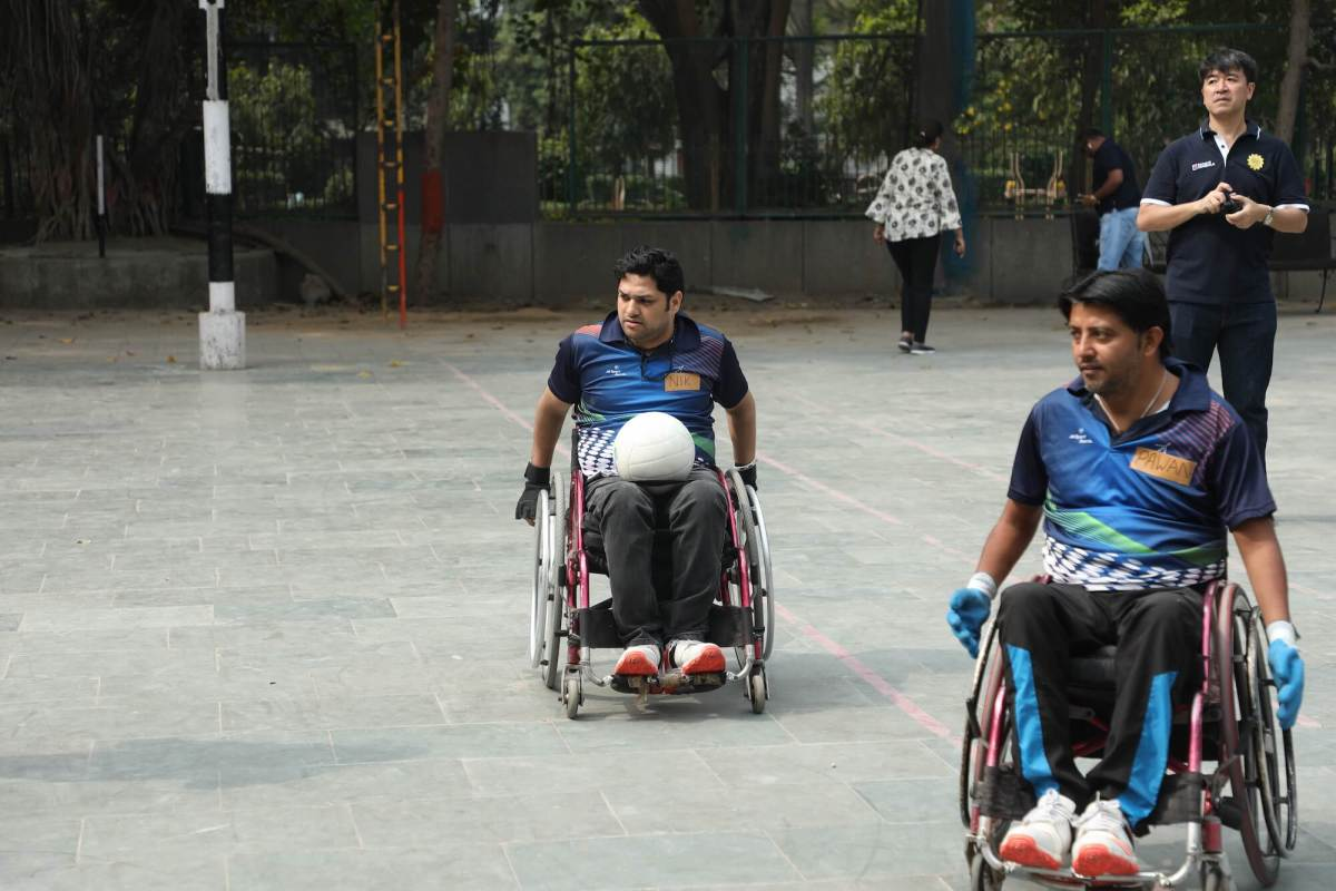 Nikhil playing wheelchair rugby