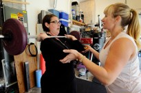 Krista Colvin, left, works out with help from Casey Stafford, a personal trainer, during a circuit boot camp exercise class in Camas, Washington April 21, 2010. It was after a similar exercise class when Krista was showering she discovered a lump in her breast.