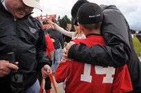 Krista Colvin hugs her son, Wes, after the Little League team won a game to advance during a baseball tournament Friday July 2, 2010 in Vancouver, Washington. Krista has completed one round of chemotherapy, and this summer is enduring a second, more taxing series of treatments.