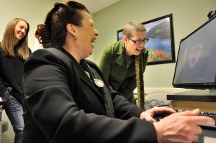 """Krista Colvin laughs with her oncologist, Dr. Kalibaba, foreground, and her friend Lisa Algstam, left, Wednesday November 10, 2010, as they review a scan that shows Krista's body is free of cancer. """"I have good news for you: Everything is wonderful,"""" says Dr. Kolibaba. """"No suspicious spots anywhere in the body. There's just nothing there."""""""