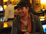 Me. Holding a beer and smiling. Wearing WordPress 10th Anniversary tshirt.