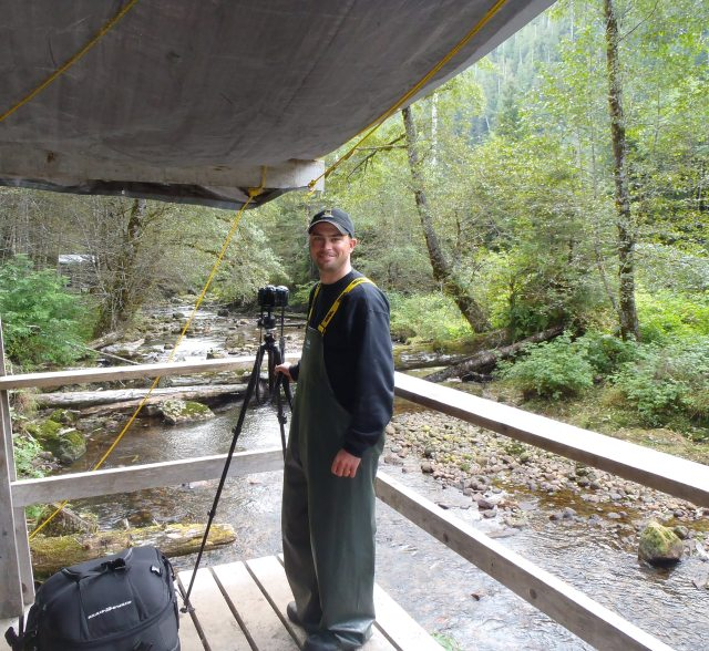Me, on a viewing platform on an undisclosed island in The Great Bear Rainforest waiting for the elusive Spirit Bear to emerge.