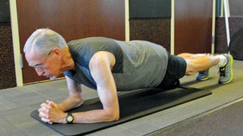 """The author does an excercise called """"planks"""" to enhance overall core strength."""