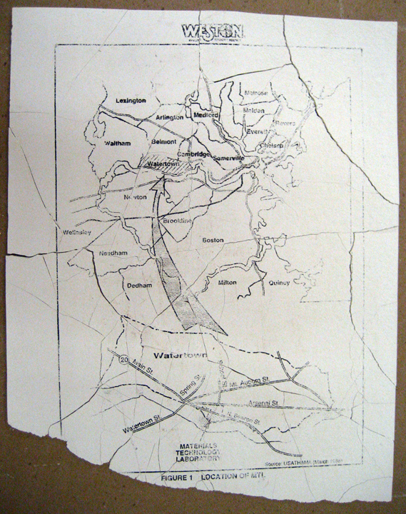 A test print of a map indicating Watertown's location--unfired broken tile