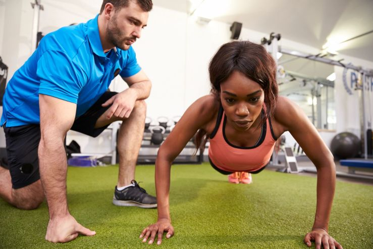 Persist until something happens. Girl with trainer doing push ups