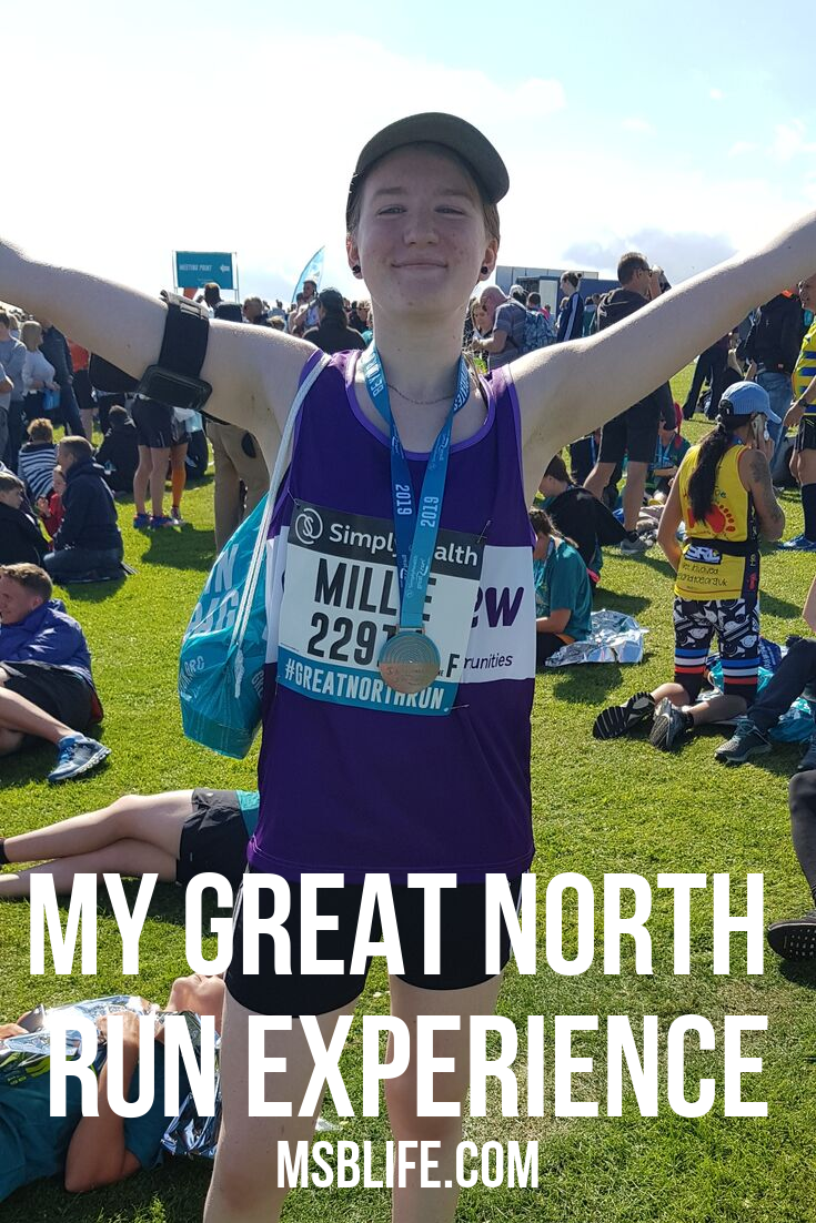 Pinterest graphic with me standing celebrating finishing with Great North Run 2019 medal