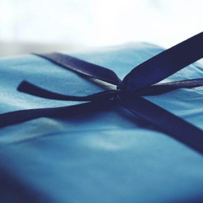 canva-close-up-photo-of-tied-blue-box-MADGv1BgJ7E