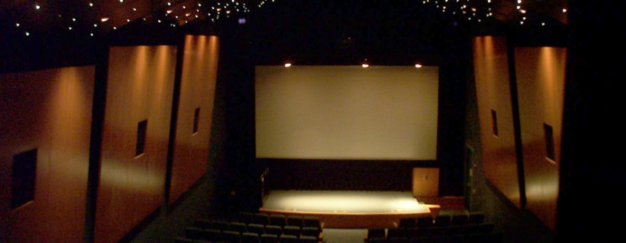 photo of theater with central projection screen