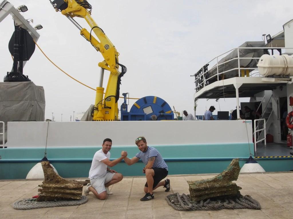 Mateusz Polakowski in front of a boat
