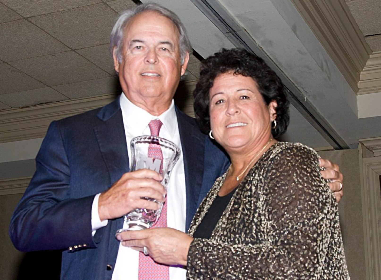 George Bryan receives MGA award from Golf Hall of Famer Nancy Lopez.