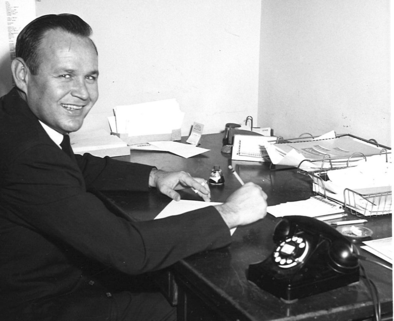 Ace Cleveland, at his desk, circa 1960.